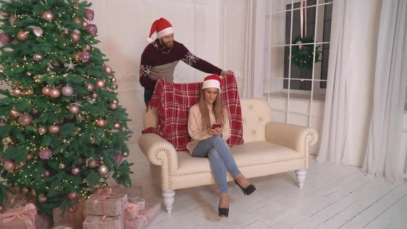 Thumbnail for Couple in Love Using Mobile Phone in Christmas.