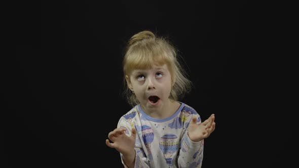 Thumbnail for Little Girl in Pajama Is Dancing and Playing on Black Background. Happiness