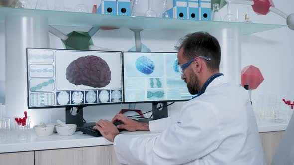 Man in Research Center Working on Computer