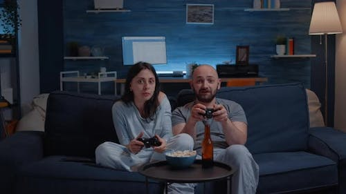 Determinated Excited Couple Winning Video Games