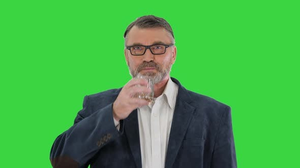 Thumbnail for Confident Mature Businessman Drinking Whiskey on a Green Screen Chroma Key