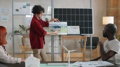 Engineer Presenting Alternative Energy Project to Colleagues