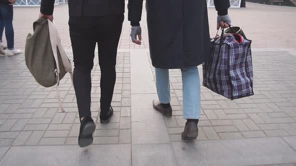 Business Man with Tramp Male Walking on Street