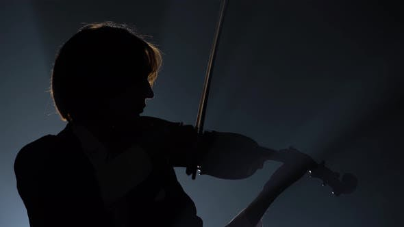 Thumbnail for Violinist Performing in a Dark Studio with a Lantern