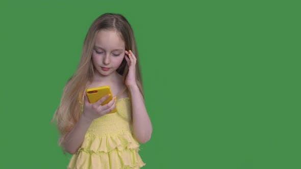 Thumbnail for Teen Girl with Long Hairs Is Browsing Her Mobile Phone on Keyed Green Background