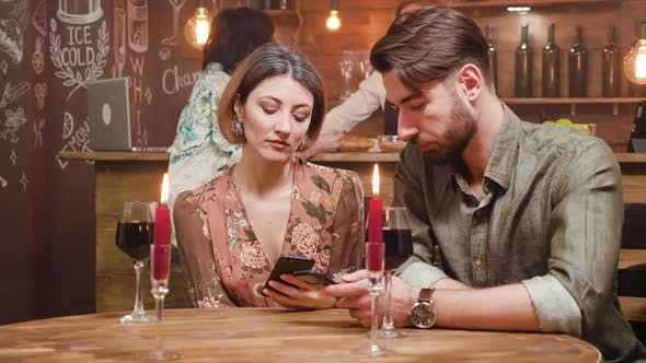 Thumbnail for Couple Addicted To Social Media While on a Date