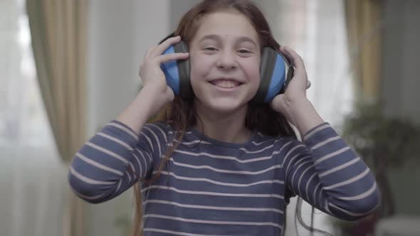 Thumbnail for Happy Girl with Headphones Dancing and Listening To the Music