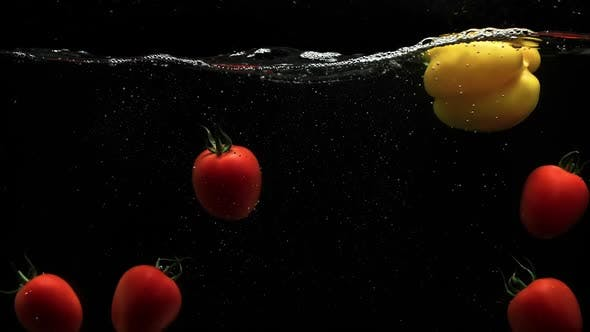 Thumbnail for Fresh Vegetables Red Cherry Tomatoes And Yellow Bell Pepper Under Water With Lot Of Air Bubbles