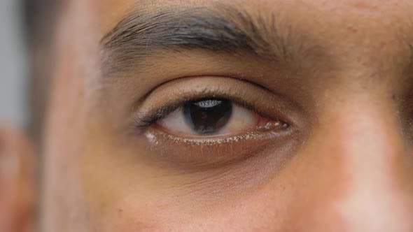 Close Up of South Asian Male Eye with Brown Iris 45