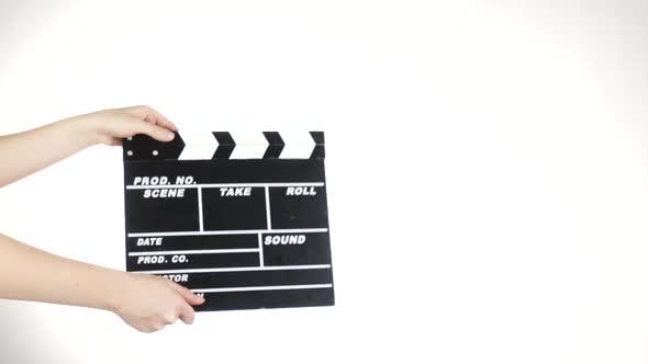Thumbnail for Person Uses Movie Production Clapper Board, on White