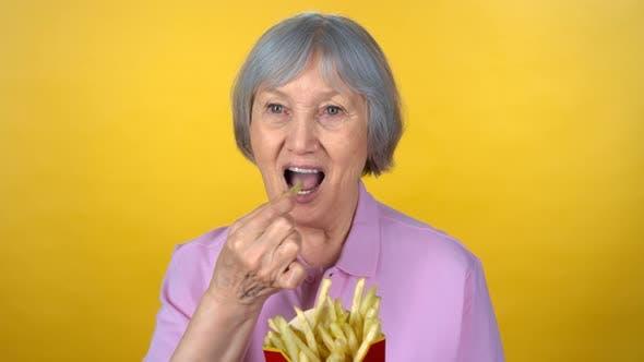 Thumbnail for Portrait of Elderly Woman Eating Fries