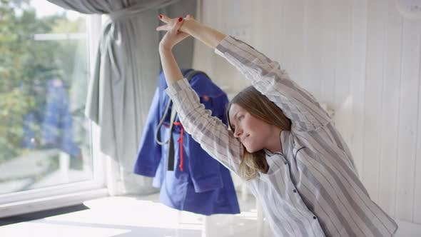 Cover Image for Cheerful Woman Stretching in Morning