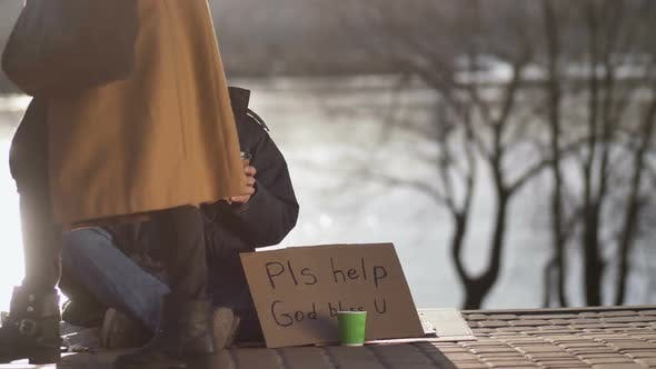 Thumbnail for Female Sharing Hot Coffee with Homeless Man