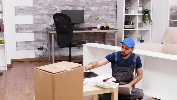 Thumbnail for Male Worker Wearing a Cap While Using His Laptop
