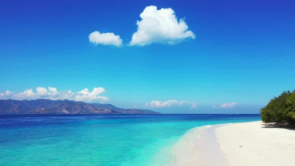 Thumbnail for Beautiful birds eye tourism shot of a white sand paradise beach and aqua blue water background