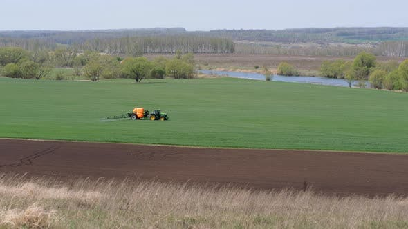 Sowing, Processing of Fields. Pest Control. Trailer Sprayer in Operation.