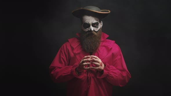 Adult Man with Long Beard Dressed Up Like a Spooky Captain