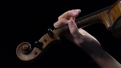 Violinist Performs a Composition on a Violin