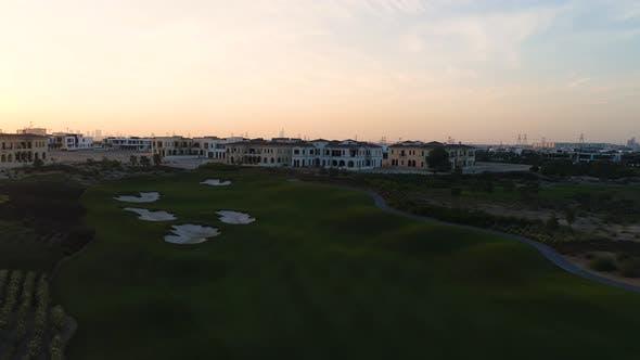 Thumbnail for Aerial view of nightfall on a luxury residential neighborhood, Dubai, U.A.E.