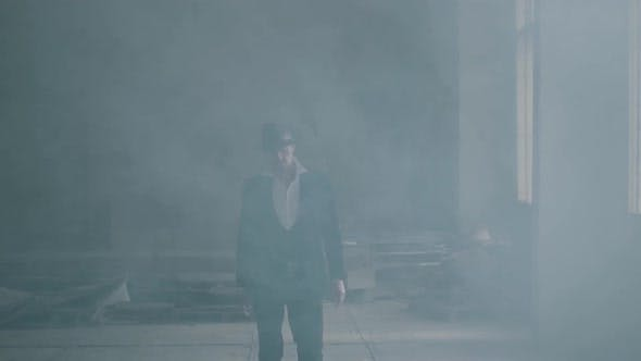 Thumbnail for Portrait Confident Brutal Gangster in Fedora Hat and Classical Suit Walk From Smoke
