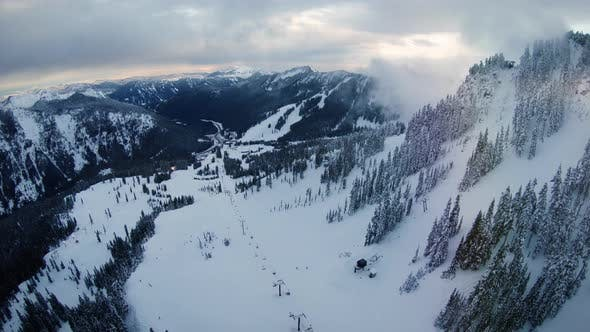 Cover Image for Winter Ski And Snowboard Resort Aerial Above Chairlifts