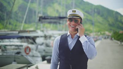 Captain walking and speaking to phone