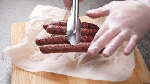 Sausages Fried with Sauce on Parchment Paper