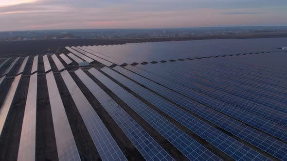 Thumbnail for Aerial Drone View Into Large Solar Panels at a Solar Farm at Sunset. Solar Cell Power Plants