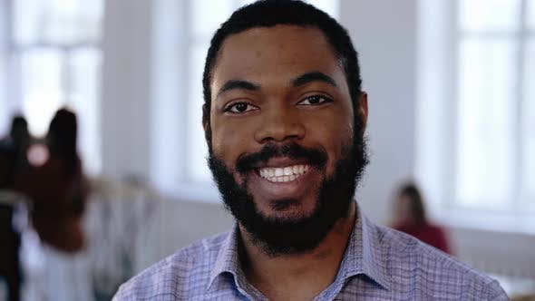Thumbnail for Close-up Portrait of Happy Positive Smiling African Manager Businessman with Beard at Modern Office