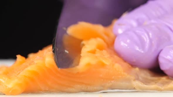 Thumbnail for Sushi Chef Cuts a Slice of Trout. Close Up
