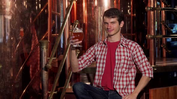 Thumbnail for Young Male Brewer Examining Freshly Brewed Beer, Working at His Brewery