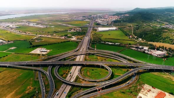 Thumbnail for Aerial View of a Freeway Intersection Traffic Trails in Portugal