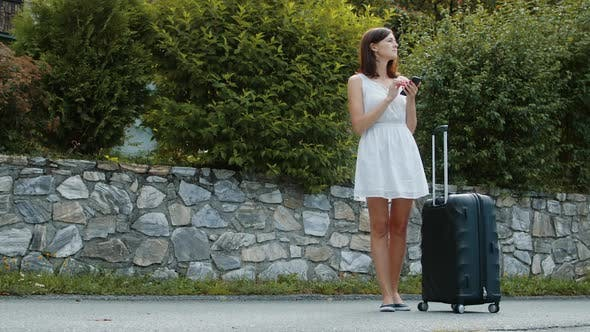 Thumbnail for Tourist Girl with Suitcases Using the Maps App