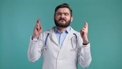 Doctor Man Praying Over Blue Background