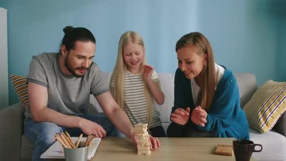 Friendly Family Has Fun Playing Jenga at Home