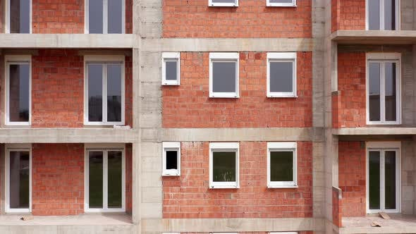 Apartment building under construction: outer wall made of bricks