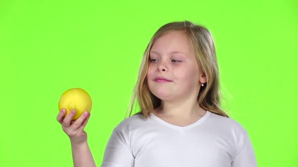 Thumbnail for Little Girl Is Holding a Lemon and Sniffing It, Green Screen, Slow Motion