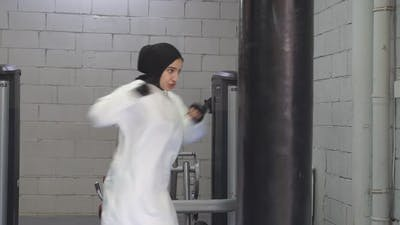 Confident Muslim Woman Stands in the Pose of a Fighter Boxing in the Gym Boxing in the Fitness