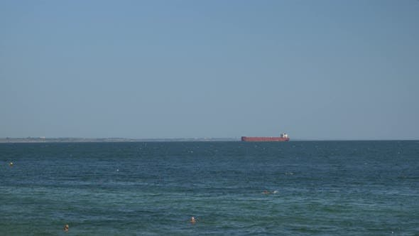 Large container ship in sea, time lapse. Bulk carrier ship is sailing in open ocean.