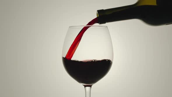 Thumbnail for Pouring red wine from a bottle into a glass