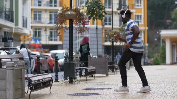 Thumbnail for Groovy Man Performing Afrohouse Dance on Street