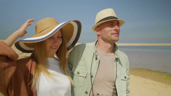 Thumbnail for Happy Couple Walking on Beach Together