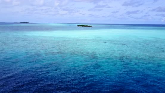 Thumbnail for Daytime fly over clean view of a white sandy paradise beach and turquoise sea background