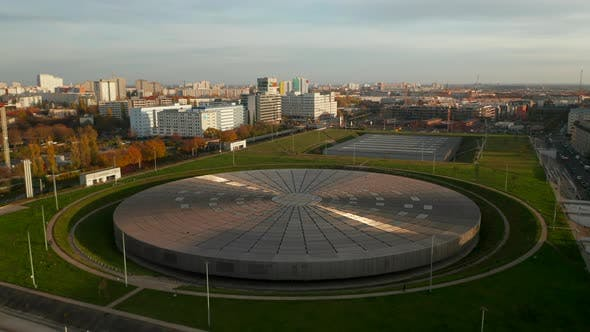 Establishing Shot Above Futuristic Velodrome Building Cycling Arena in Berlin, Germany, Aerial View
