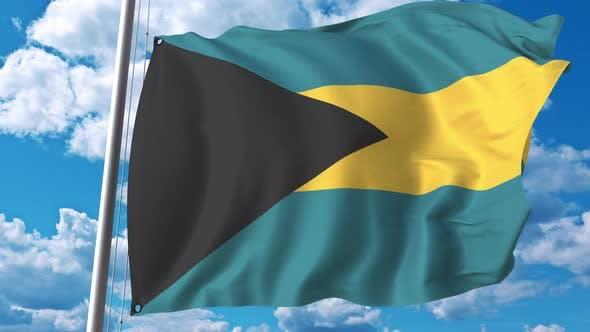 Thumbnail for Fliegende Flagge der Bahamas auf dem Hintergrund des Himmels