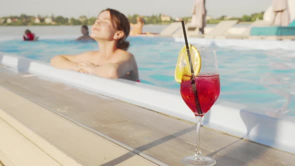 Thumbnail for Happy Young Woman Relaxing After Swimming in Outdoor Pool