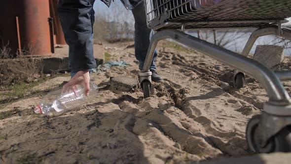 Homeless Man Feet Taking Plastic Bottle