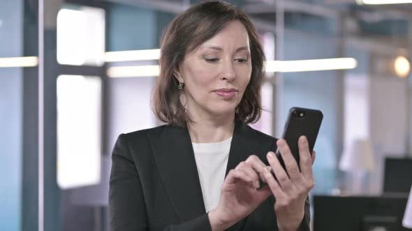 Thumbnail for Portrait of Cheerful Middle Aged Businesswoman Using Smartphone
