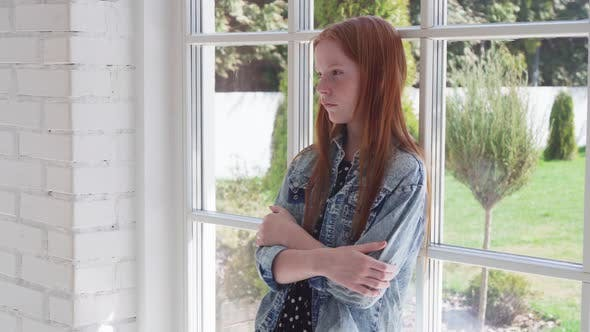 Cover Image for Lonely Sad Girl Standing By Window