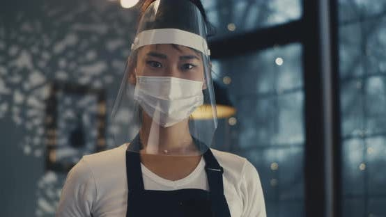 Thumbnail for Young Asian Cafe Worker in Face Protection During Pandemic